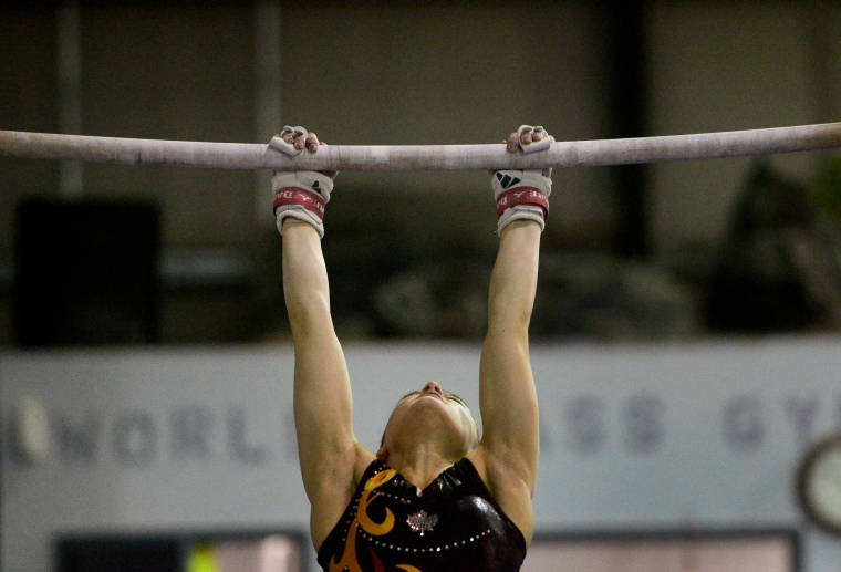 Hamilton. Ontario, Tuesday, January 21,2014 - Gymnast Maegan Chant, who trains at World Class gymnastics, has her sights set on the Olympics inn 2016. Maegan hangs on to the bar. Photo by: Barry Gray, The Hamilton Spectator.