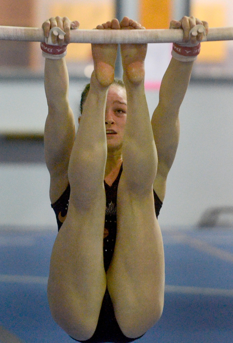Hamilton. Ontario, Tuesday, January 21,2014 - Gymnast Maegan Chant, who trains at World Class gymnastics, has her sights set on the Olympics inn 2016. Maegan concentrates on the uneven parallel bars. Photo by: Barry Gray, The Hamilton Spectator.