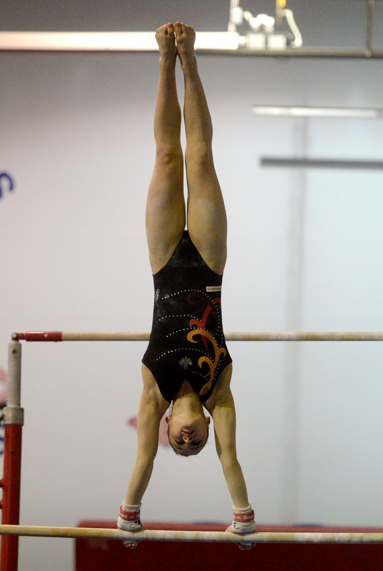 Hamilton. Ontario, Tuesday, January 21,2014 - Gymnast Maegan Chant, who trains at World Class gymnastics, has her sights set on the Olympics inn 2016. Maegan works out on the bars. Photo by: Barry Gray, The Hamilton Spectator.