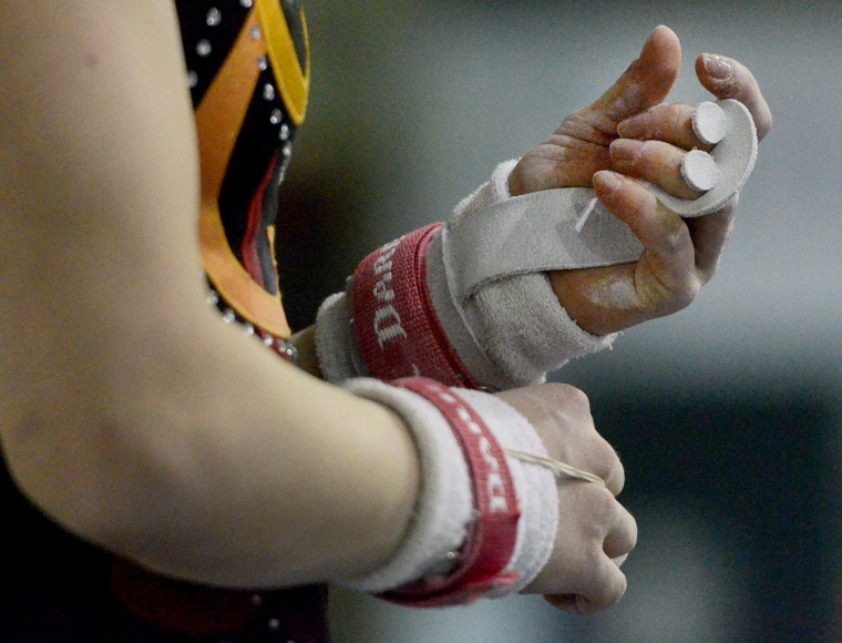 Hamilton. Ontario, Tuesday, January 21,2014 - Gymnast Maegan Chant, who trains at World Class gymnastics, has her sights set on the Olympics in 2016. Maegan wraps her hands before working out on the uneven parallel bars. Photo by: Barry Gray, The Hamilton Spectator.