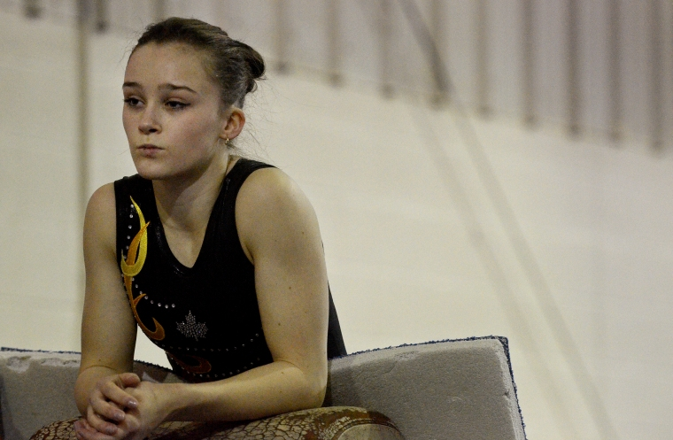 Hamilton. Ontario, Tuesday, January 21,2014 - Gymnast Maegan Chant, who trains at World Class gymnastics, has her sights set on the Olympics inn 2016. Maegan waits her turn to practice a technique. Photo by: Barry Gray, The Hamilton Spectator.