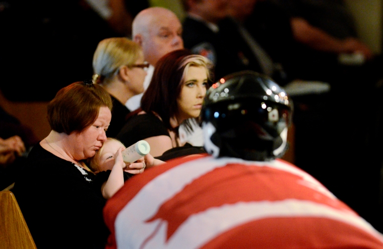 Hamilton. Ontario, Friday, June 7, 2013 - Memorial service for ORNGE paramedic Chris Snowball, who was killed in a helicopter crash last week. Chris' wife, Allie Scott, holding their 2 year old daughter Danica, listens to the service. Photo by: Barry Gray, The Hamilton Spectator.