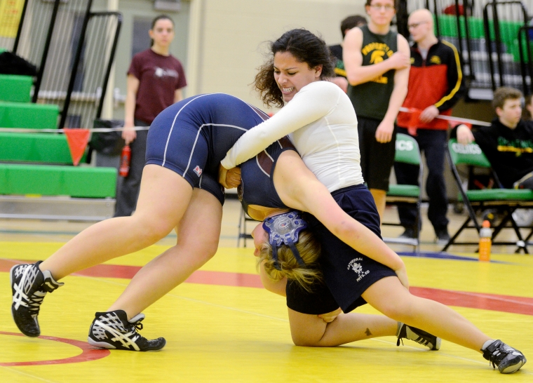 Hamilton. Ontario, Thursday, February  20,  2014 - GHAC wrestling, at Bishop Ryan S.S. Arianna Romo from Cathedral fkips Kaila Sloat from King's CC in the 77k division.  Photo by: Barry Gray, The Hamilton Spectator.