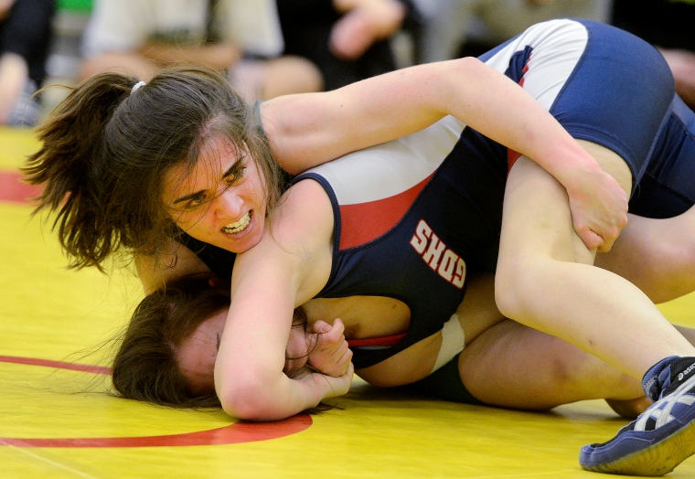 Hamilton. Ontario, Thursday, February  20,  2014 - GHAC wrestling, at Bishop Ryan S.S. BR's Amber Tesone battles with Georgetown's Cassidy Kornohonen in the girls 57.5k division. Photo by: Barry Gray, The Hamilton Spectator.